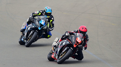 Robbin Harms (27) and David Johnson (16) on their MotoDex Performance First BMWs at Donington Park. image by Jon Jessop Photography