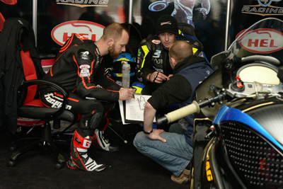 Harms and Davo talk tactics in the MotoDex garage. image by Jon Jessop Photography